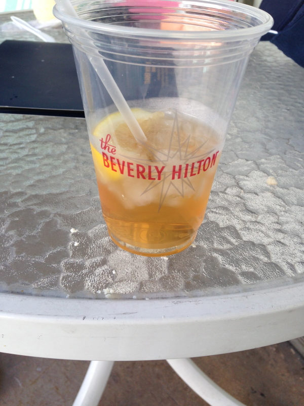 Sipping an iced tea poolside at the Beverly Hilton