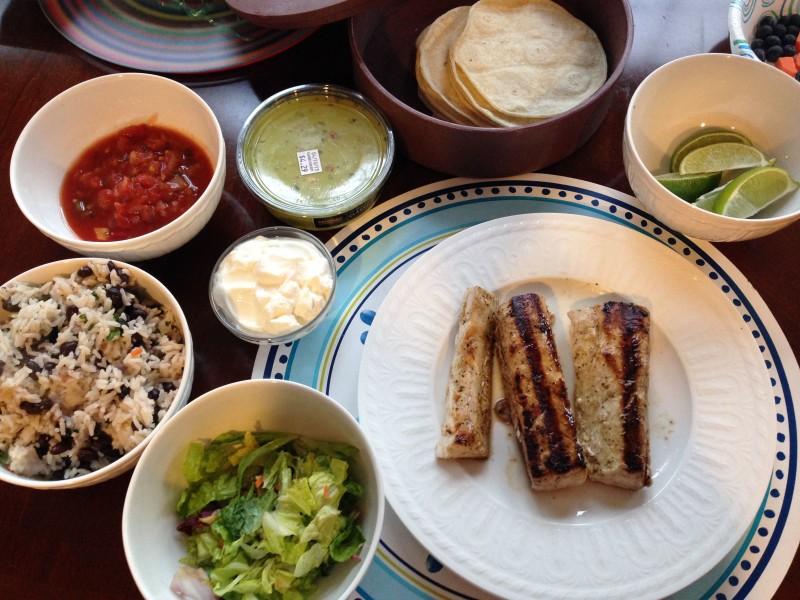 Once grilled, I served the mahi mahi alongside sour cream, guac, rice and beans, pico de gallo and shredded lettuce