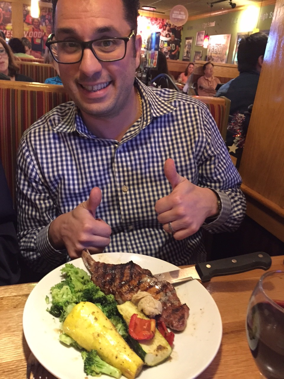 Mike gives his Wood Fired Grilled Pork Chop 2 thumbs up
